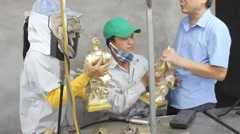 Workers castigate bronze casting products, Asia Stock Footage