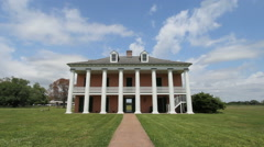 Columns grace the facade of a plantation house Stock Footage