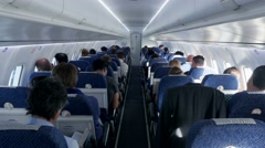 inside airplane view. passengers sitting in airplane. people traveling. flight - stock footage