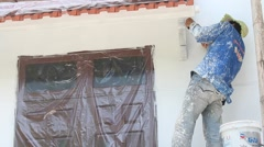 Painter painting wall in home Stock Footage