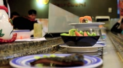 Sushi on conveyor belt in Japanese restaurant Stock Footage
