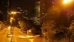 Traffic lights. modern buildings. urban background. time lapse of city at night Stock Footage