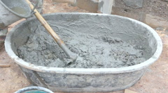labor mix concrete for construction - stock footage