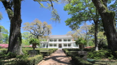 Louisiana Rosedown Plantation house framed in trees c Stock Footage
