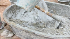 Labor mix concrete for construction Stock Footage