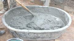 labor mix concrete for construction - stock footage