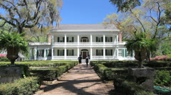 Louisiana Rosedown Plantation house with tourists on walkway c Stock Footage