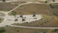 Aerial view of Lost Hills oil donkeys - stock footage