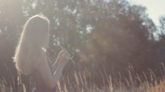 Nice blonde girl on the nature Stock Footage