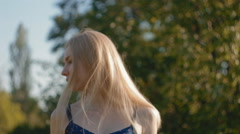 Pretty blonde girl laught in fromt of the camera Stock Footage