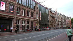 tram driving through the city of Amsterdam - stock footage