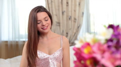 Alluring girl in lingerie smiling, flirting, talking in bedroom, click for HD - stock footage