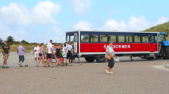 Turists intering the Skagen beach train  Stock Footage