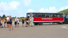 Turists leaviing the Skagen beach train  Stock Footage
