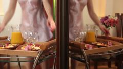 Woman in nightdress taking tray with breakfast from table, click for HD Stock Footage