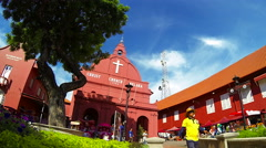 MELAKA - JUNE 2014: Time lapse of Christ Church with people. Malaysia. 4K Stock Footage