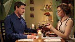 Man accidentally stains shirt while on romantic date with woman, click for HD Stock Footage
