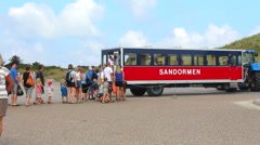 Sandormen brings turists to the beach Stock Footage