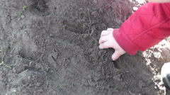 Boy playing with ground Stock Footage