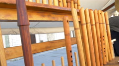 Lots of wooden flutes on display on the rack gh4 4k uhd Stock Footage