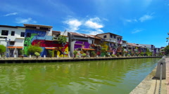 Time lapse of Melaka river and colourful buildings with tourist boat. 4K Stock Footage