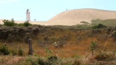 Rubjerg lighthouse in the sandbanks Stock Footage