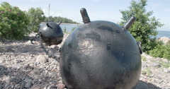 Two big sea mines from the old war placed on the ground gh4 4k uhd Stock Footage