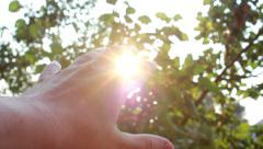 Man Hand Reach To The Sun Stock Footage