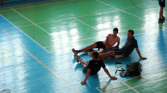 Badminton Players Sit In Center Of Sports Grounds Stock Footage