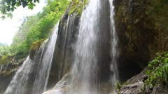 Beautiful waterfall falling off a cliff, Chegem Gorge, North Caucasus , Russia Stock Footage