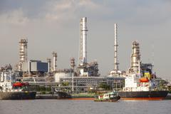 oil refinery and tanker ship on port in heavy industry use for energy - stock photo