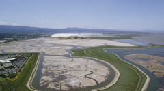 Aerial view of Silicon Valley area salt flats in California - stock footage