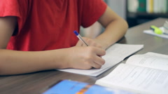 Pupil wearing casual clothes, studying in his room, desktop, close-up Stock Footage