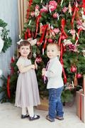 Children decorate a christmas tree for christmas Stock Photos