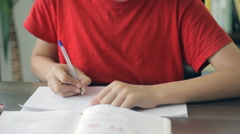 Young boy writing in notebook in his room close-up, studying, homework, dolly Stock Footage