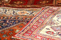 Colorful and beautiful rugs in pure virgin wool available in a stall at the m Stock Photos