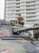 Soldier sitting on tank Stock Photos