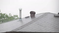 Stock Video Footage of heavy rain hitting the roof of a house