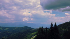 Clouds forming over mountain top Stock Footage