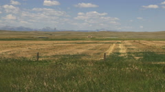 Montana ranch land with distant mountains s Stock Footage