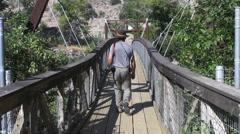 Montana Great Falls Ryan Dam foot bridge to Ryan Is Park s Stock Footage