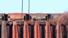 Dumping iron ore down chutes Stock Footage