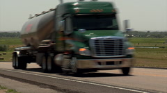 Two heavy trucks on rural highway Stock Footage