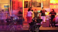 Shanghai Food Street night time lapse 30 fps pan right Stock Footage