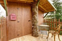 tree house deck with entrance door - stock photo