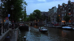 Stock Video Footage of Romantic view of a canal in Amsterdam in the evening