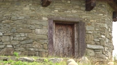 Wooden door of a stone church 4K Stock Footage