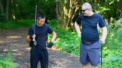 Hikers with six pack and overweight in forest on trail Stock Footage