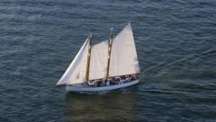 Aerial view of white sailed sailing ship Stock Footage