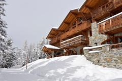 Ski resort hotel in the snow Stock Photos